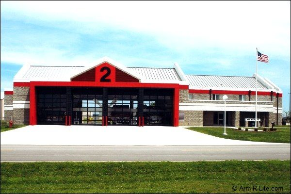 Fire Station 2 Custom Glass Garage Door With Frosted Airplane Design Spanning Four Sectional Doors Sandblasted Glass Design Glass Garage Door Overhead Door
