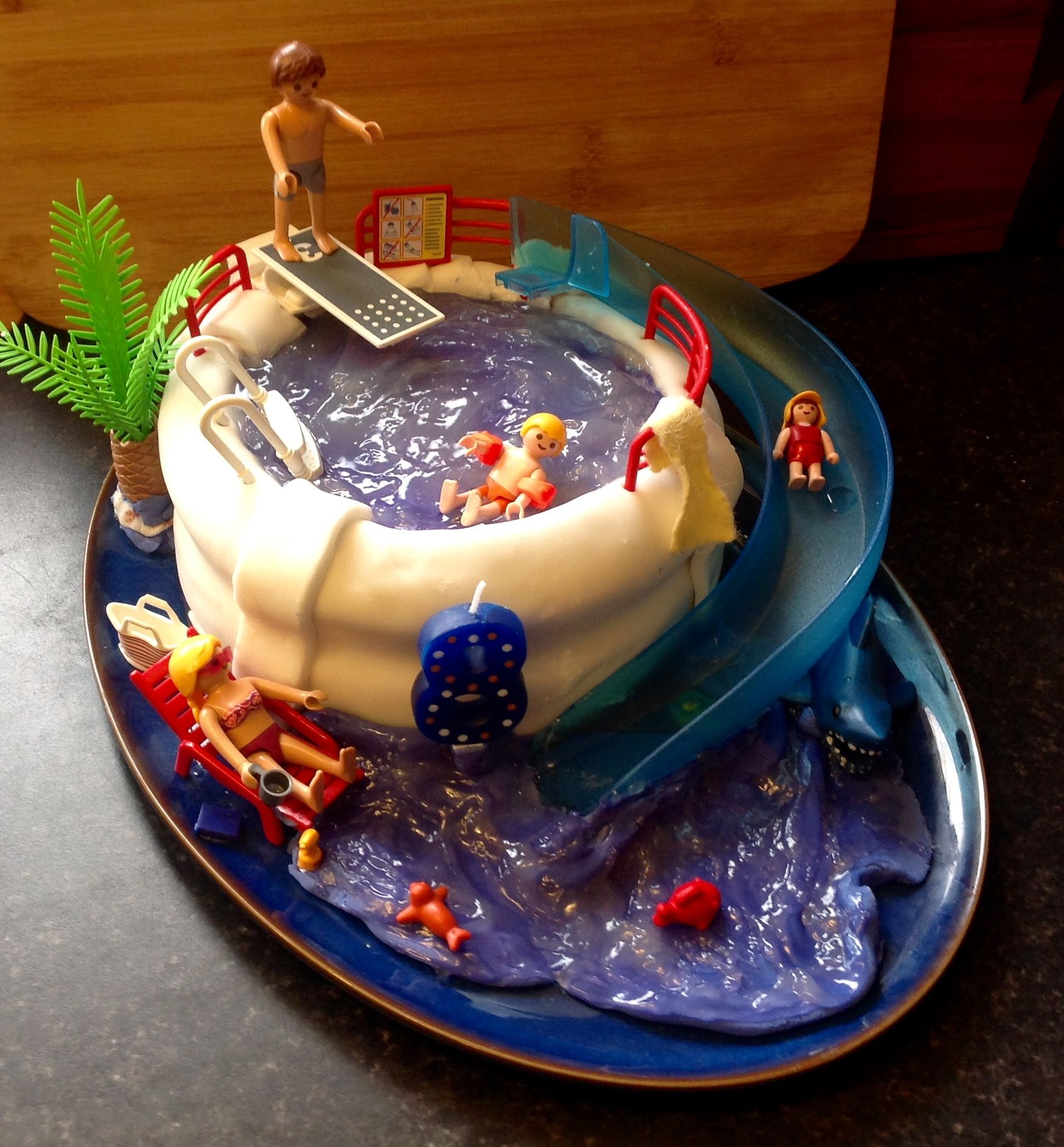 Pool party cake Using Playmobil figures really brought this design to life