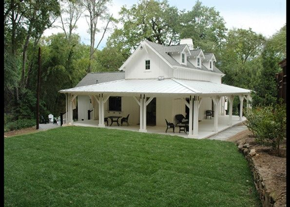 small farmhouse with wrap around porch