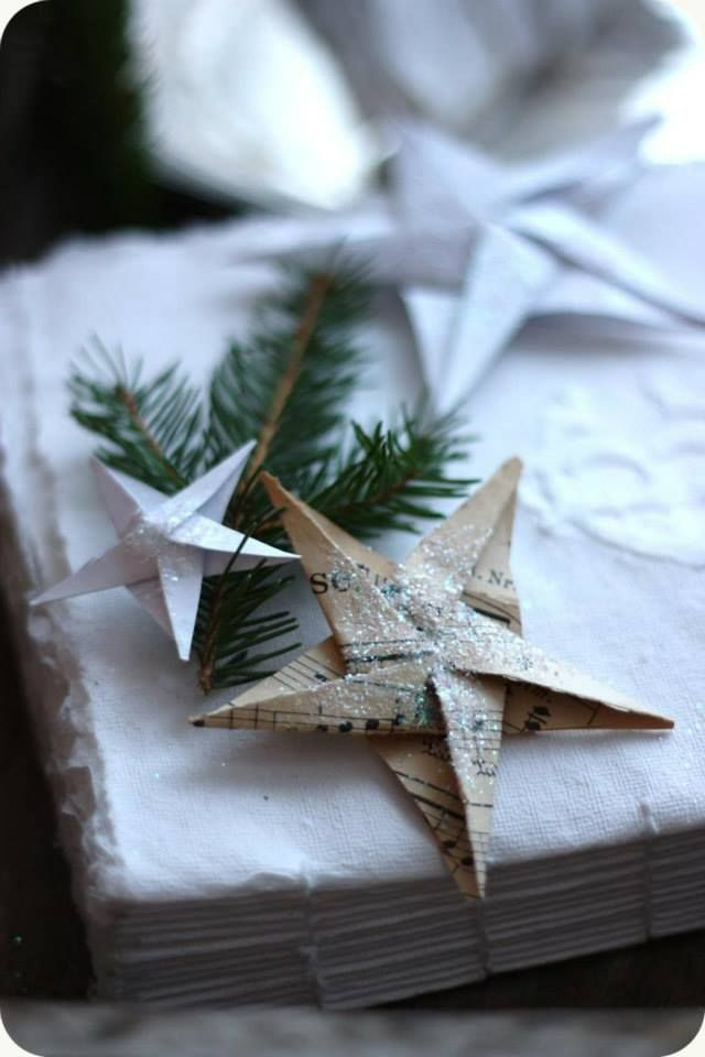 Decorated gifts with greeneries and paper stars