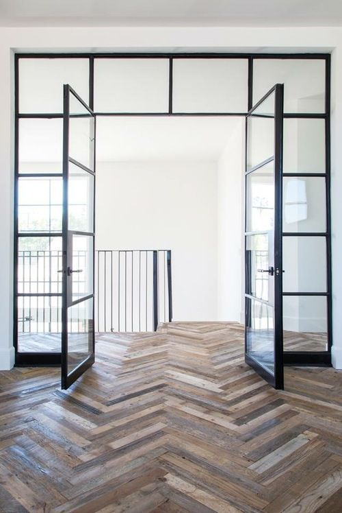 Steel doors and reclaimed wood chevron pattern.
