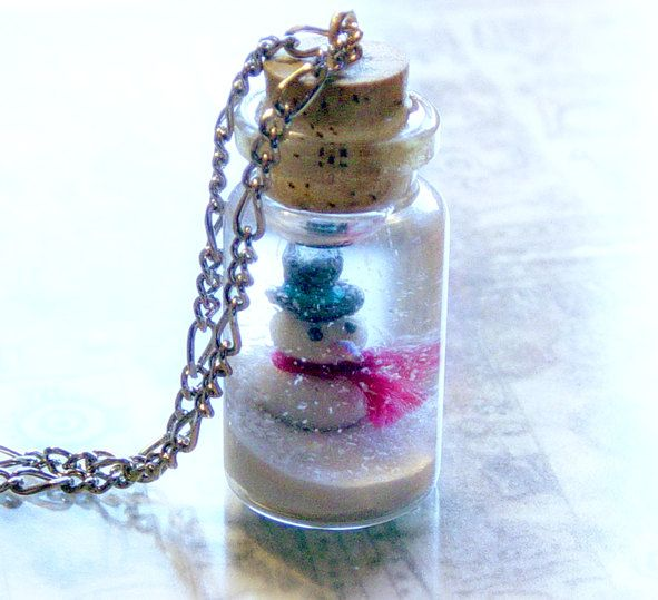 Bottle necklace with a snowman and a winter wonderland scene