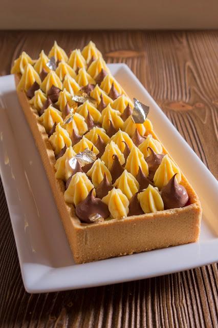 Photo of Coccole di dolcezza: Crostata cremosa ai due cioccolati mandarino