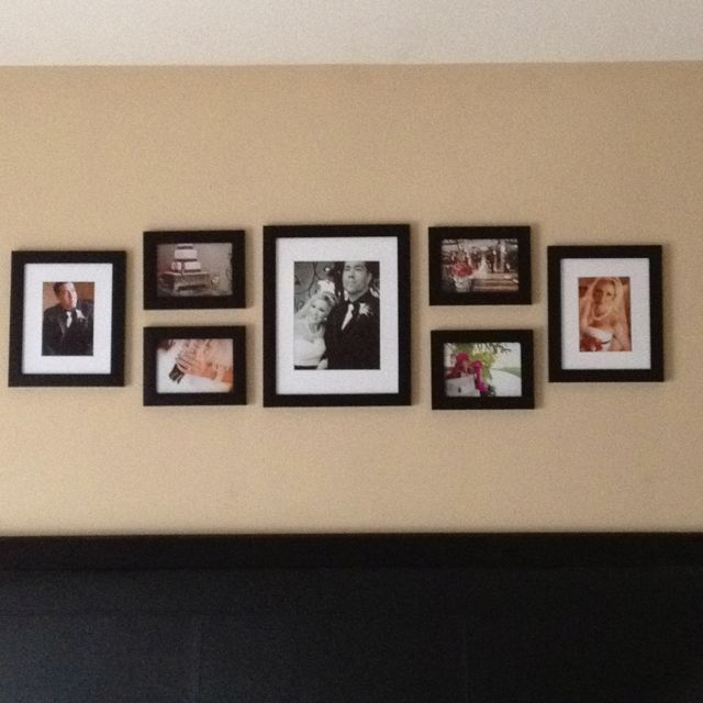 Wedding Photos Above Bed Maybe Interspersed With Bird