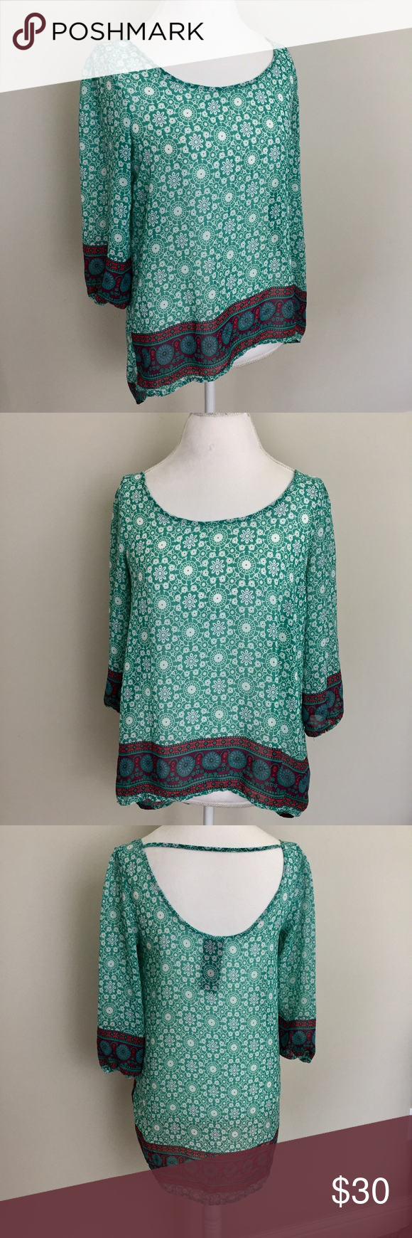 """Moon Collection Boho Tunic Top Multicolor printed boho Tunic Top by Moon Collection. Excellent condition with no flaws. Size large. Made of a silky feeling polyester. Approximate measurements flat and unstretched: pit to pit 17.5"""", front length 23.5"""", back length 28"""". ⚓️No trades or holds. I negotiate only through the offer button. Any measurements listed are approximate since I am not a seamstress. 🚭🐩HB Moon Collection Tops Blouses"""