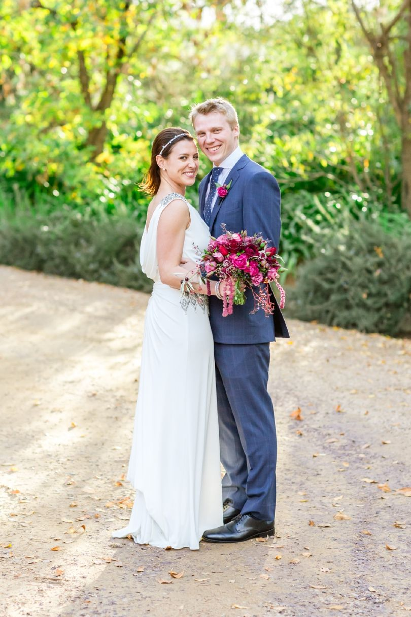 berry toned bouquet and buttonhole by Green Goddess flower studio - at Jordan wine estate Cape Town Wedding Photographer | Photography by Claire Nicola