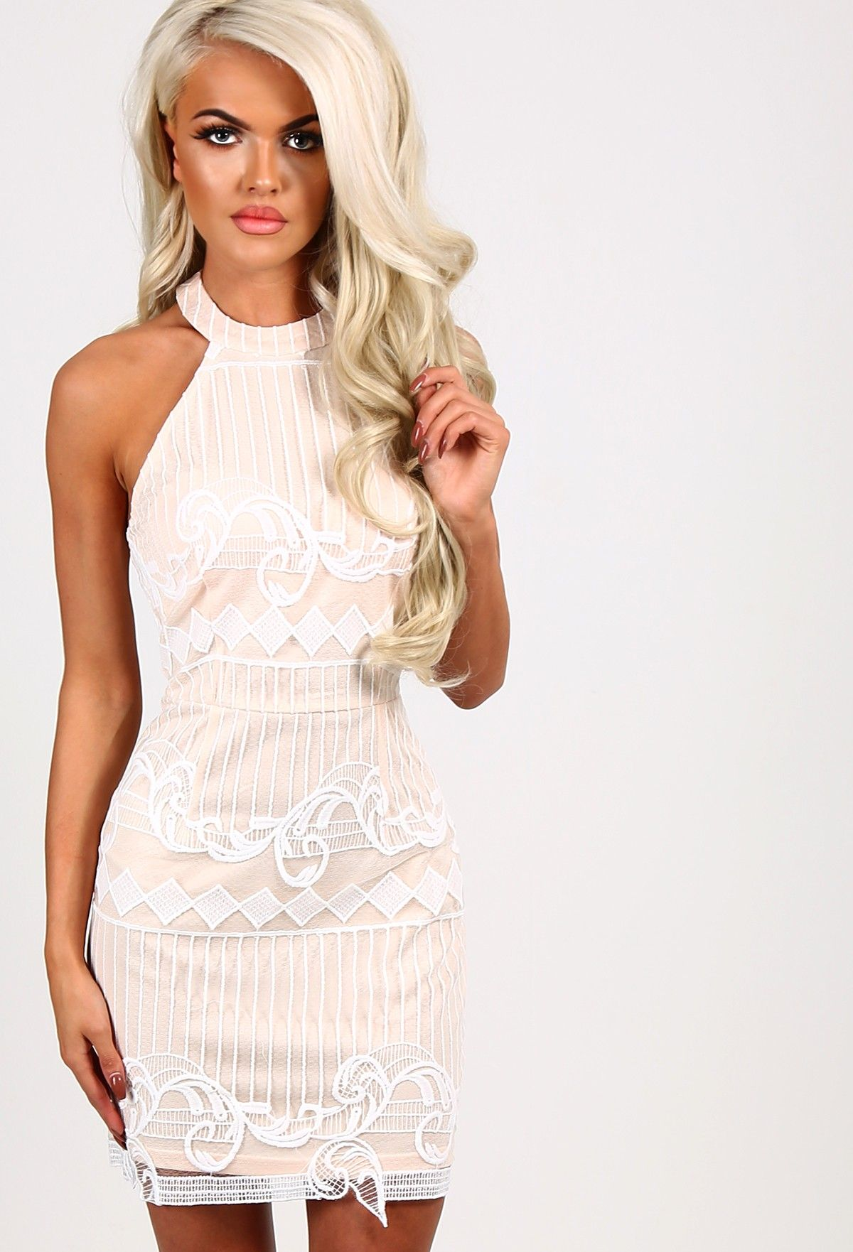 Look gorgeously girly in this nude halterneck mini dress! Featuring nude lining, white lace overlay and a concealed zip at the back. Team with high heels and a clutch to finish the look. ♥ ...