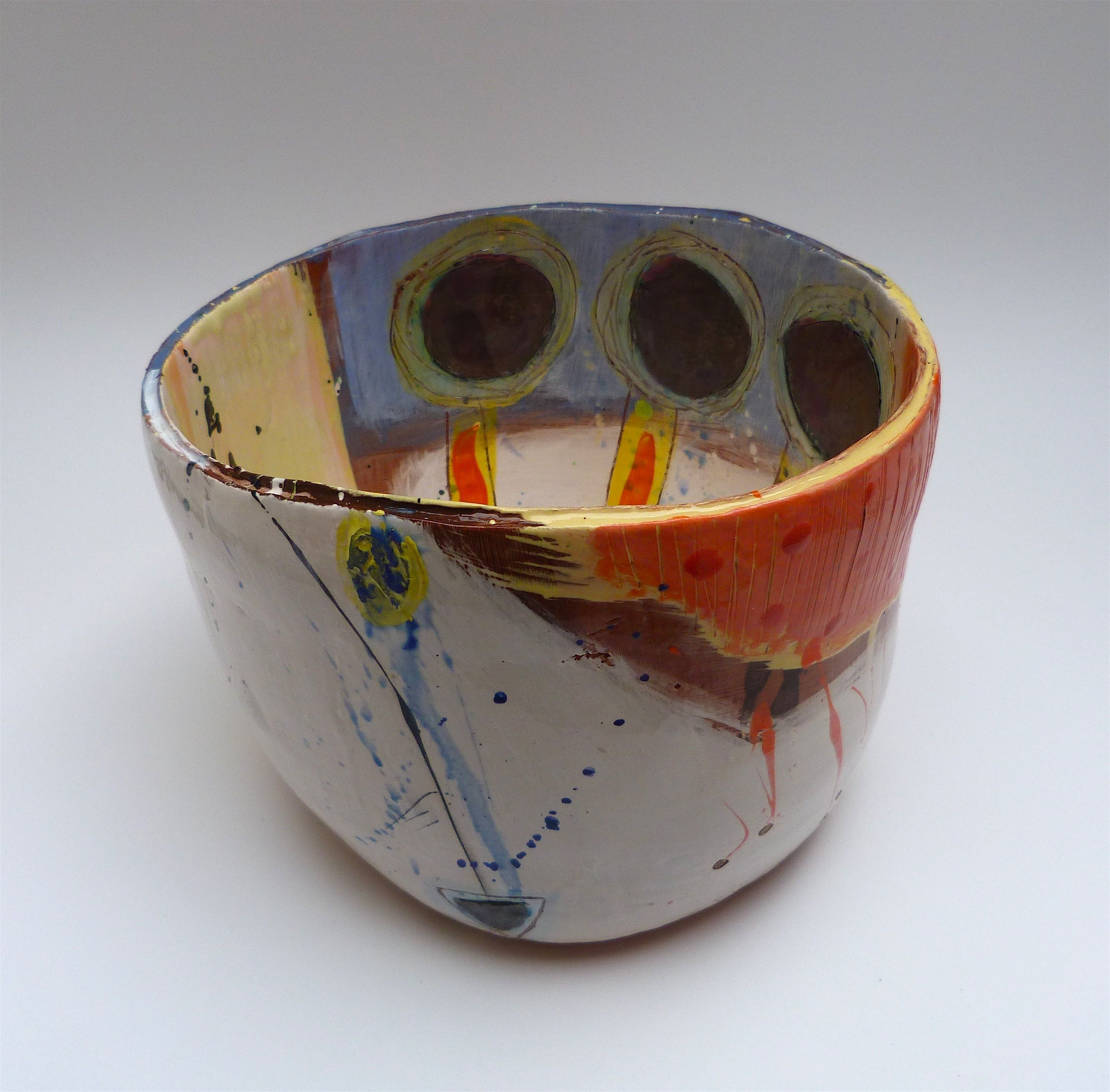 Pot with 3 interior saturated blue discs on orange/yellow stems to interior with salmon rim overlay 16cmsH x 21cmsW - back view