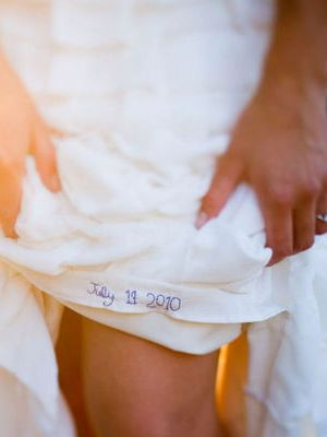 something blue...wedding date stitched into the wedding gown....wonderful!