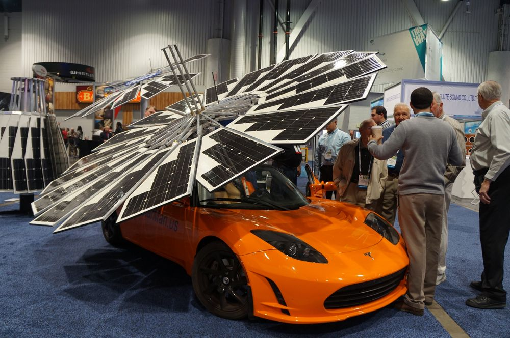 The Coolest Cars at CES 2014 By Dan Costa January 10, 2014 Tesla with Solar Fan 1 At a glance, it looks like some kind of satellite landed on this Telsa, but it is actually a fully functional solar array