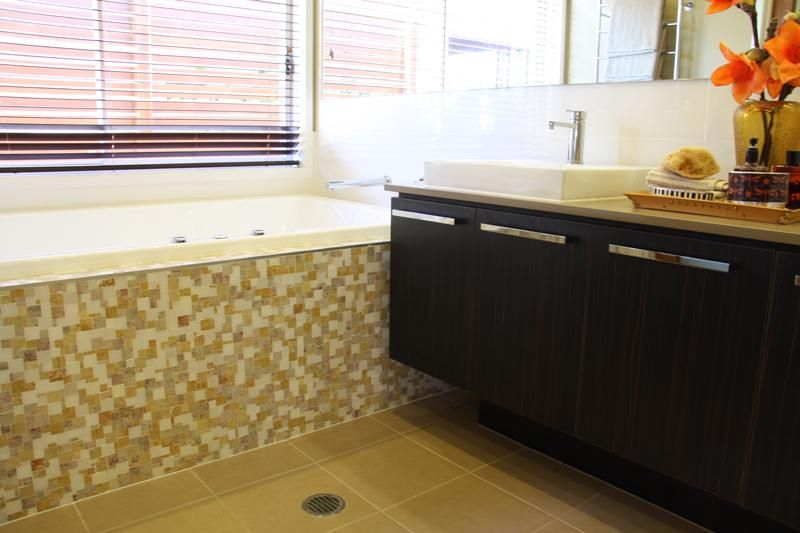 vanity close to bath, with tiled front