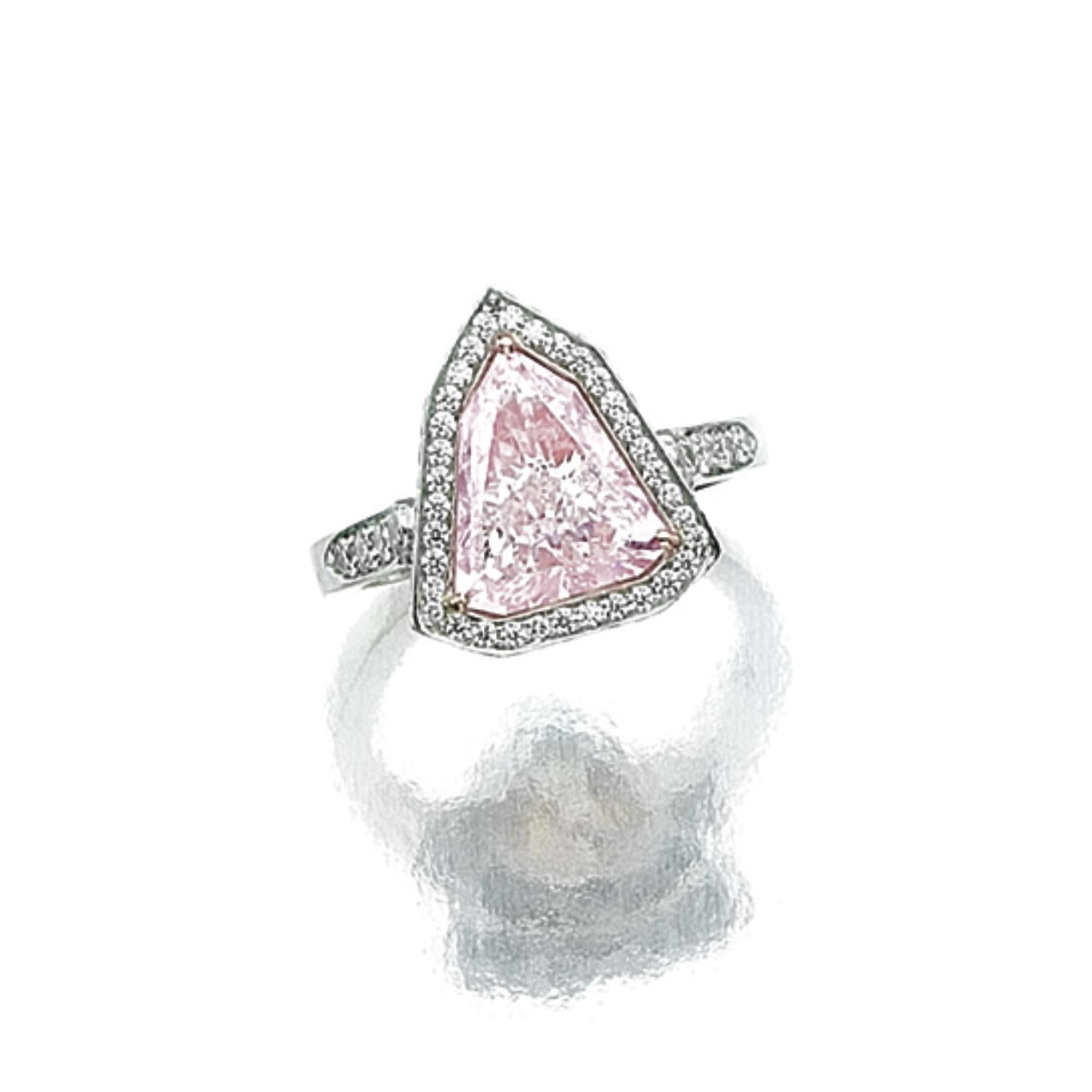 s shield fantasy with set over white shaped cut ring and rub in sapphire diamond centrally crowned gold a setting six pin