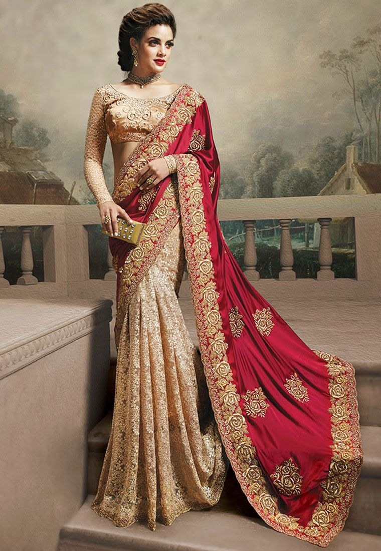 a3993756dbf9 A stunning Maroon   Cream Color Satin Net Designer Saree featuring a  stunning detailed resham embroidery