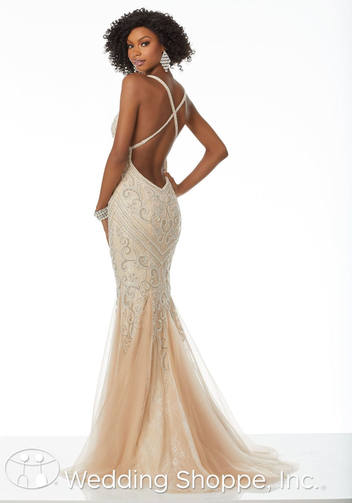 4871ec9140 Slim fit and flare prom dress with intricate beading and a deep V-neck and  open V-back. Unique