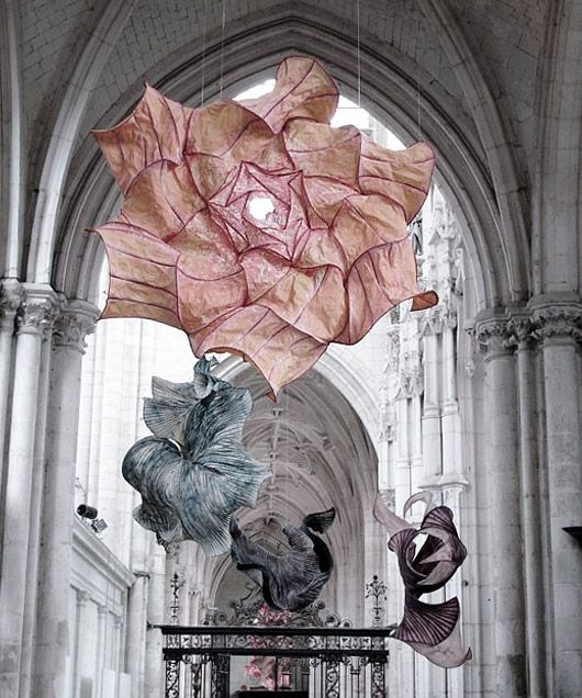 More than 100 of Peter Gentenaar's ethereal paper sculptures were installed inside the Abbey church of Saint-Riquier in France.