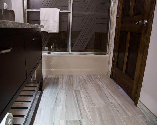 Love the light gray laminate flooring in this bathroom ...