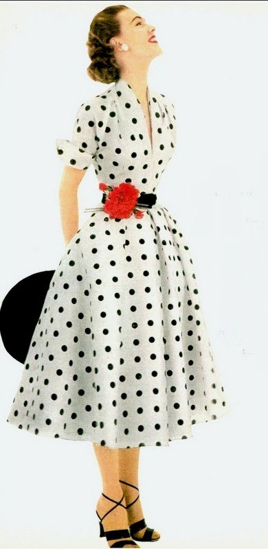 0086d0be7881 1952 Model in white and black polka-dotted dress of silk shantung by Donald  Dress