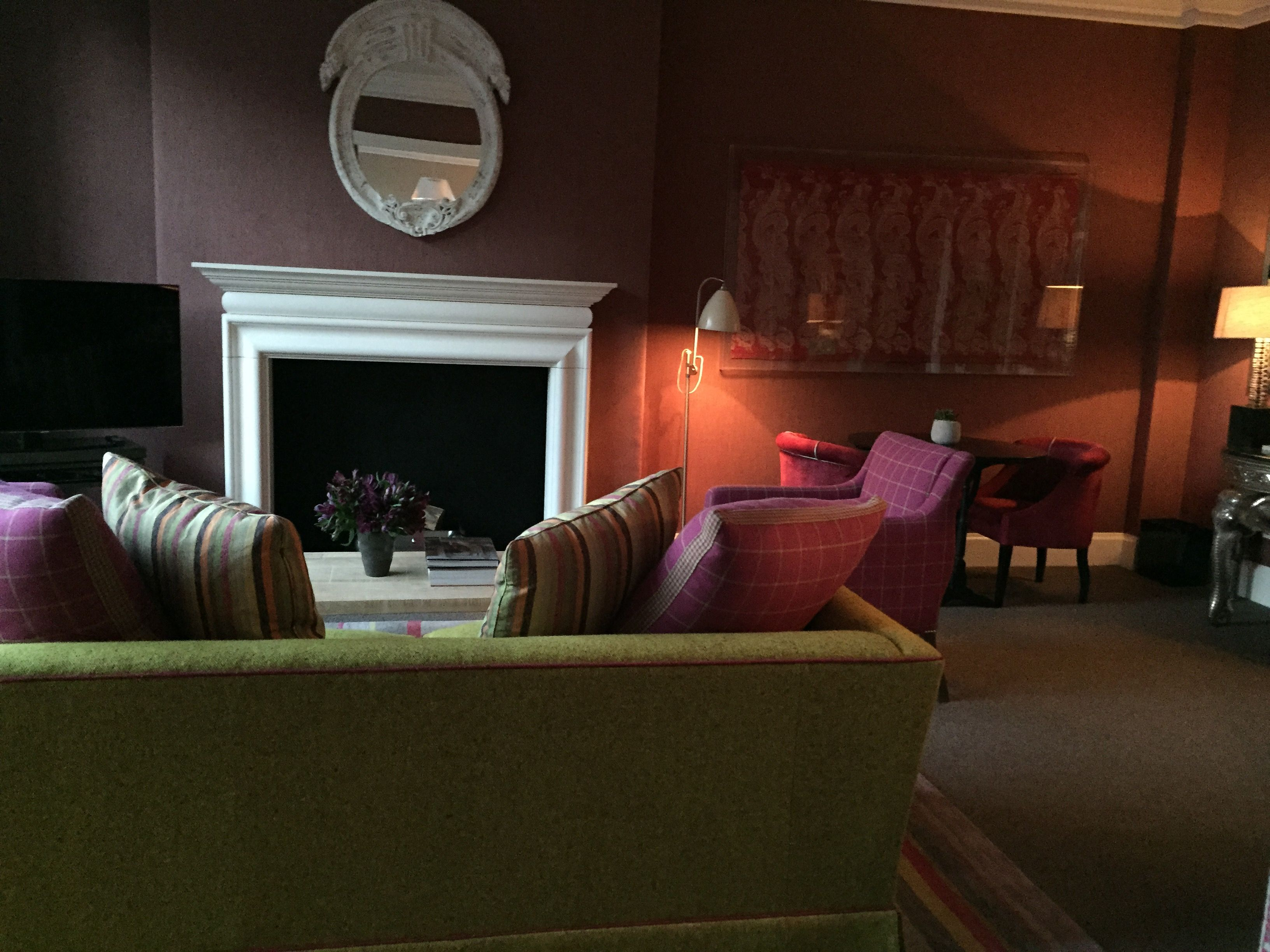 On the side of the lobby is the Crosby Bar, warm and inviting with ...