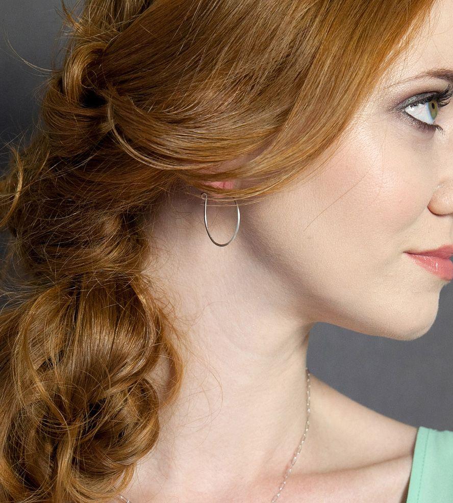 Redhead model hoop earrings