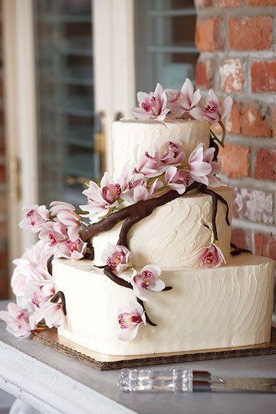 Cherry blossoms dress up this homespun buttercream cake.Photo Credit: Carrie Wildes Photography