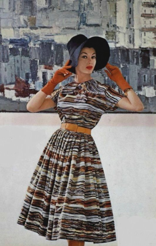 1959 Carven vintage fashion style color photo print ad day dress full skirt stripes earth tones brown black short sleeves hat model magazine