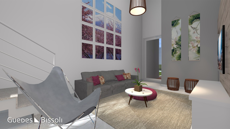 Sala de tv com quadros na parede usando a simetria deram alegria ao