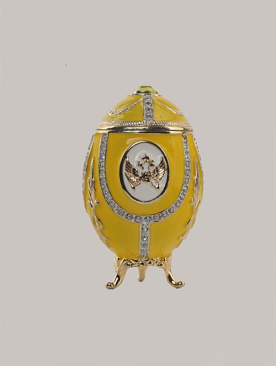 A magnificent handmade yellow Faberge Egg with gold decorations Trinket Box.  This piece is a unique one of a kind piece made for art lovers who get