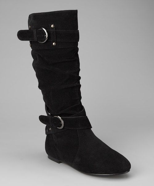 """Embrace the blissful feeling a pair of new shoes brings with these edgy boots. Faux suede adds an element of luxury while the side-zip closure makes slipping them on a simple affair.0.25"""" heel13.5"""" shaft12"""" circumferenceSide zipper closureMan-made"""