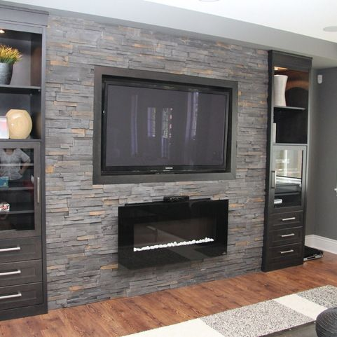Basement Family Room Design Ideas  gas fireplace with wall mount TV on grey  stone feature. Basement Family Room Design Ideas  gas fireplace with wall mount