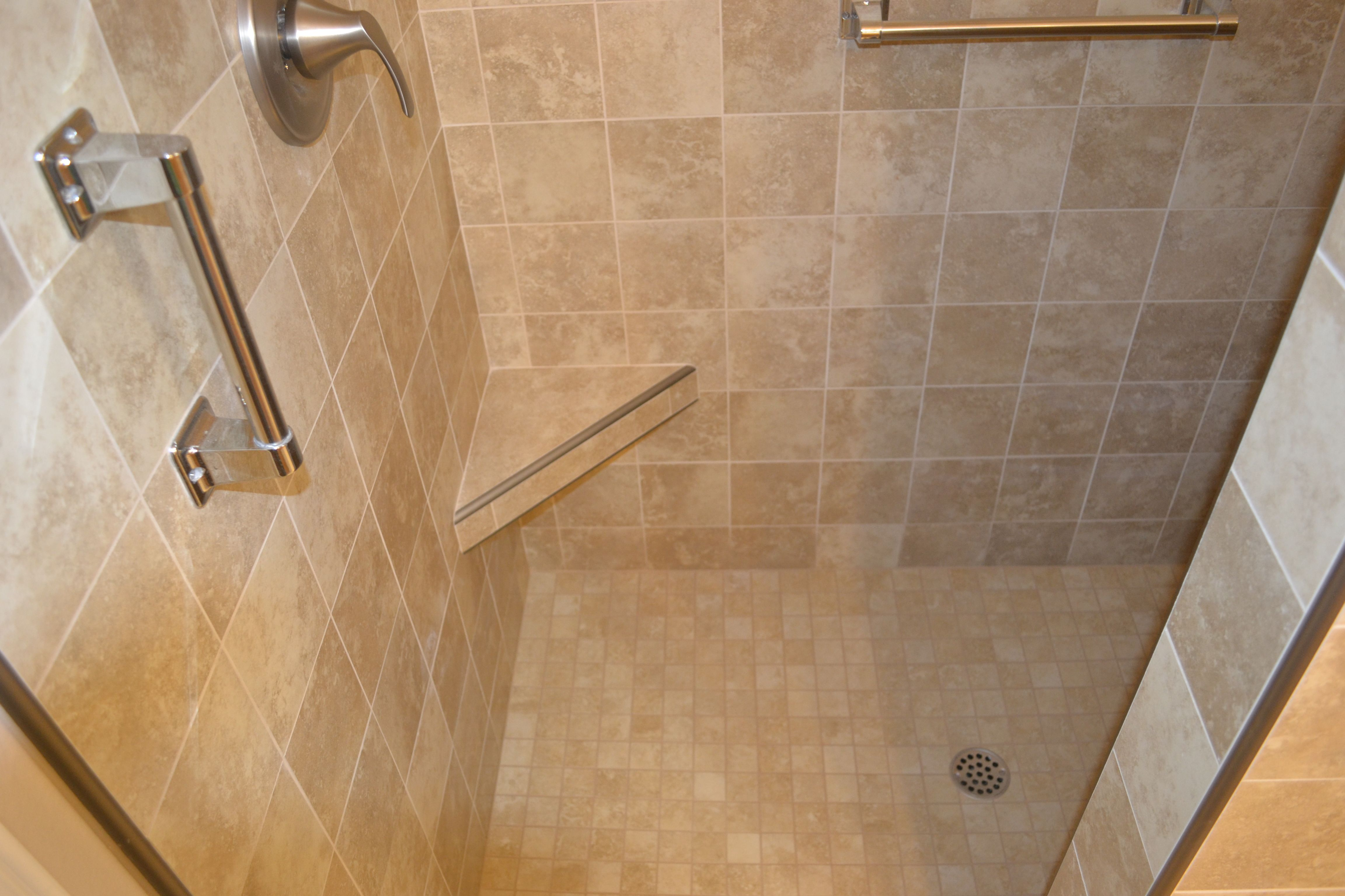 Door less shower with metal edge trim / Small Better Bench. Marcus ...