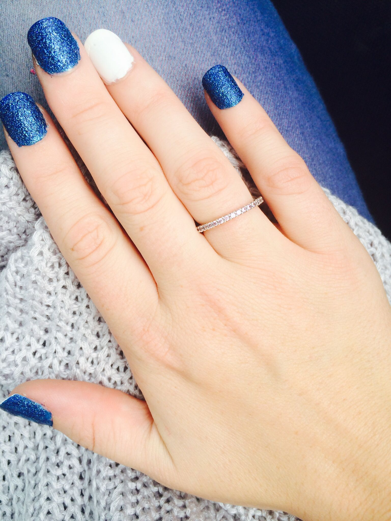 White and shimmer blue nails