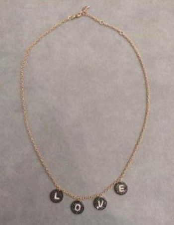 7ca6bb78043d2b Bettina Javaheri Dangling Love Necklace worn by Kyle Richards on RHOBH.  Love, love, love this. But the price is $3,375. I would love to buy a  necklace like ...