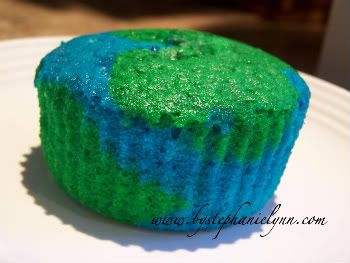 I could do a simple version of this for Earth day. BUY CAKE MIX!! Divide the cake batter and mix in blue food coloring for one and green for the other. Then spoon it into the cupcake holders and bake.