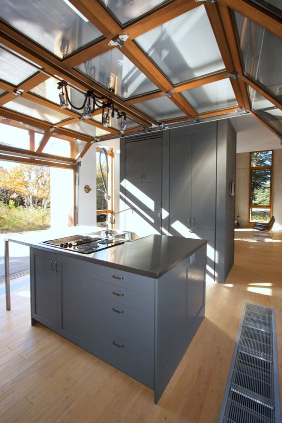 Modern Kitchen With A Roll Up Garage Door To Enjoy The Views Whole
