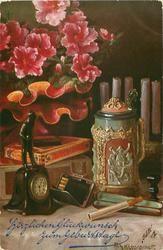 bowler statue on clock, stein, cigarettes, azalea plant behind left