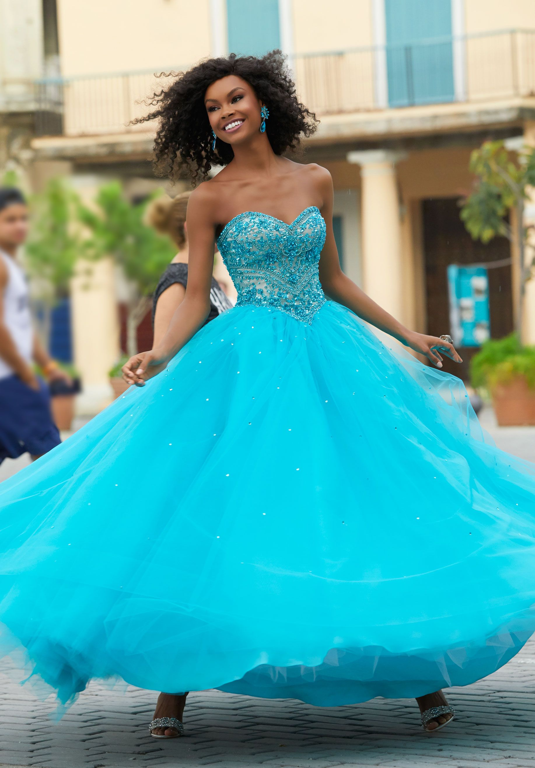 Classic prom ballgown featuring a beaded sweetheart bodice with full