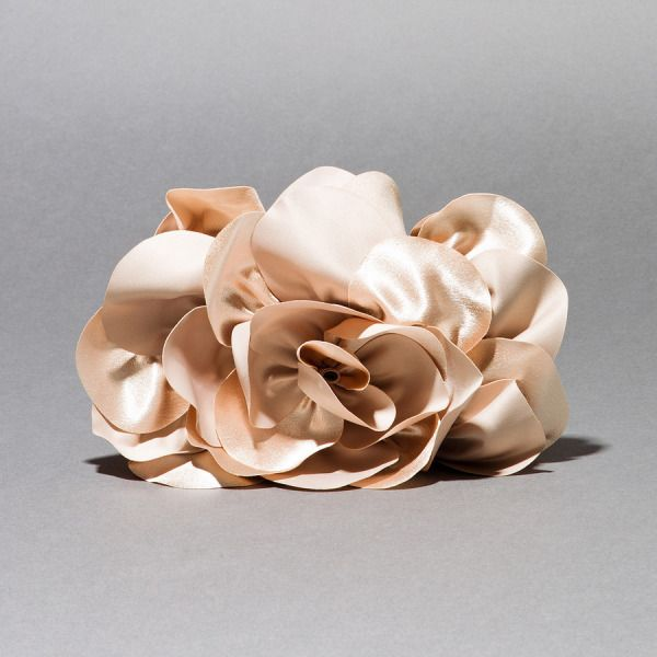 Adorable blush colored satin flower clutch. Very soft and feminine yet fresh.