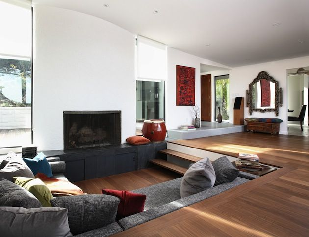 simple, fireplace, wood floor from: The Conversation Pit: 15 Fantastic Sunken Living Room Ideas | Inthralld