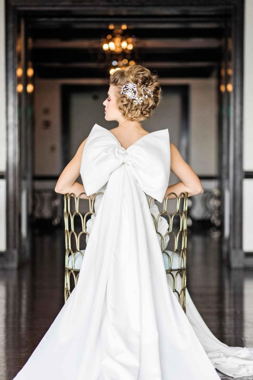 Wedding dress with bow on back  Statement bow on back of modern wedding dress  Drama Meets Romance