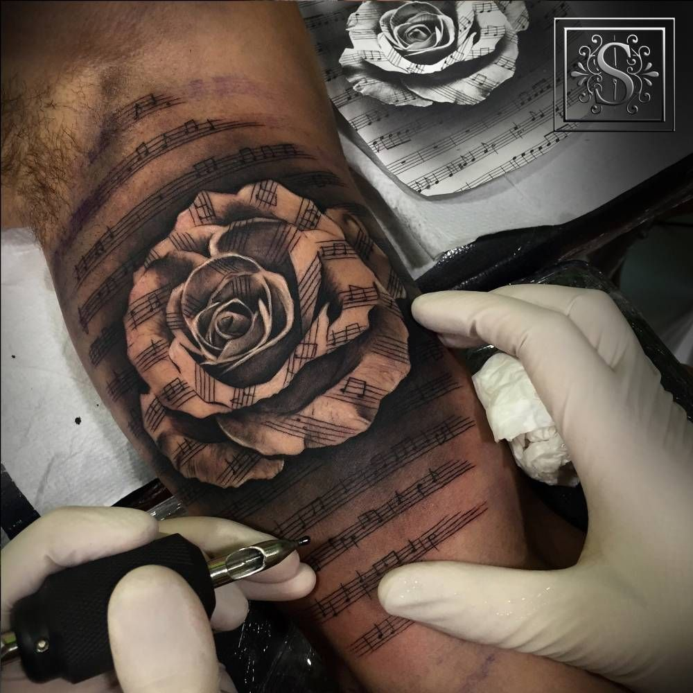 Black and grey style music staff rose tattoo artist for Black and white tattoo artists