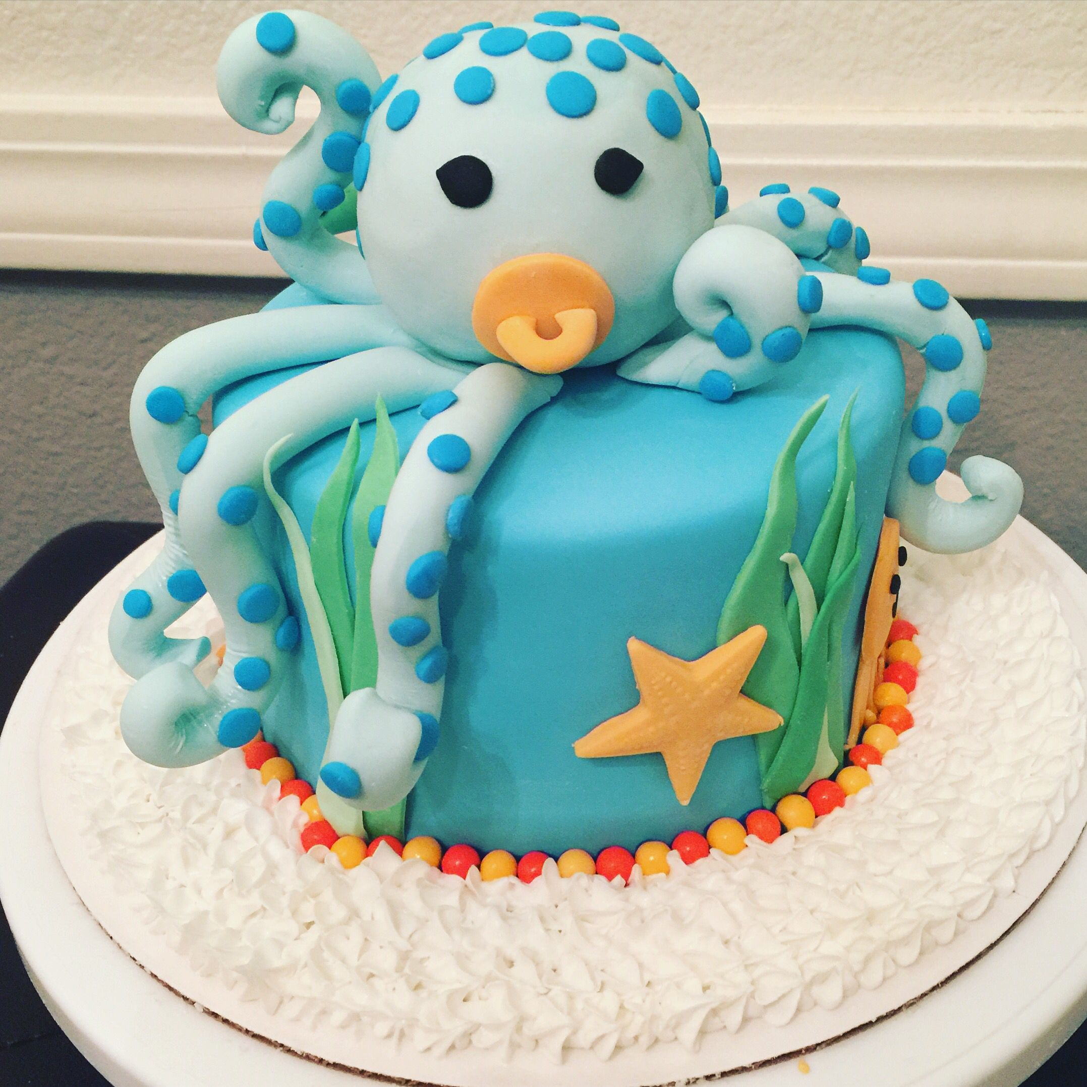 It s a boy baby octopus baby shower cake