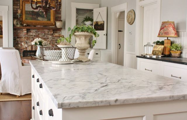 White Kitchen Cabinets Paired With Marble Countertops And