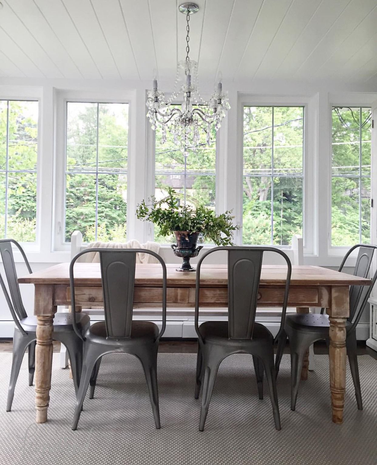 Farmhouse Table With These Metal Chair And A Bench On The Other
