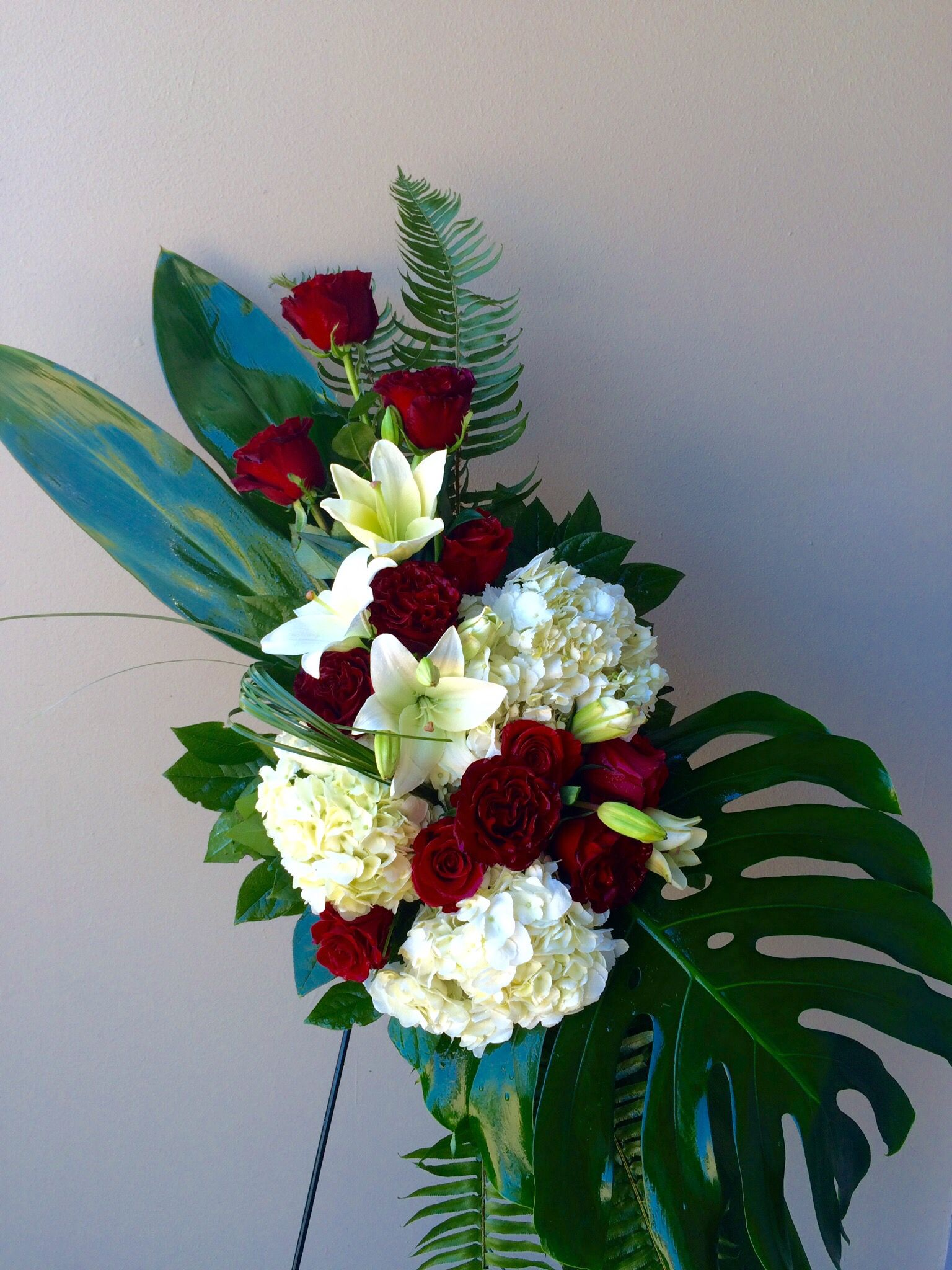 Red and white funeral spray by kc events florals houston tx red and white funeral spray by kc events florals houston izmirmasajfo