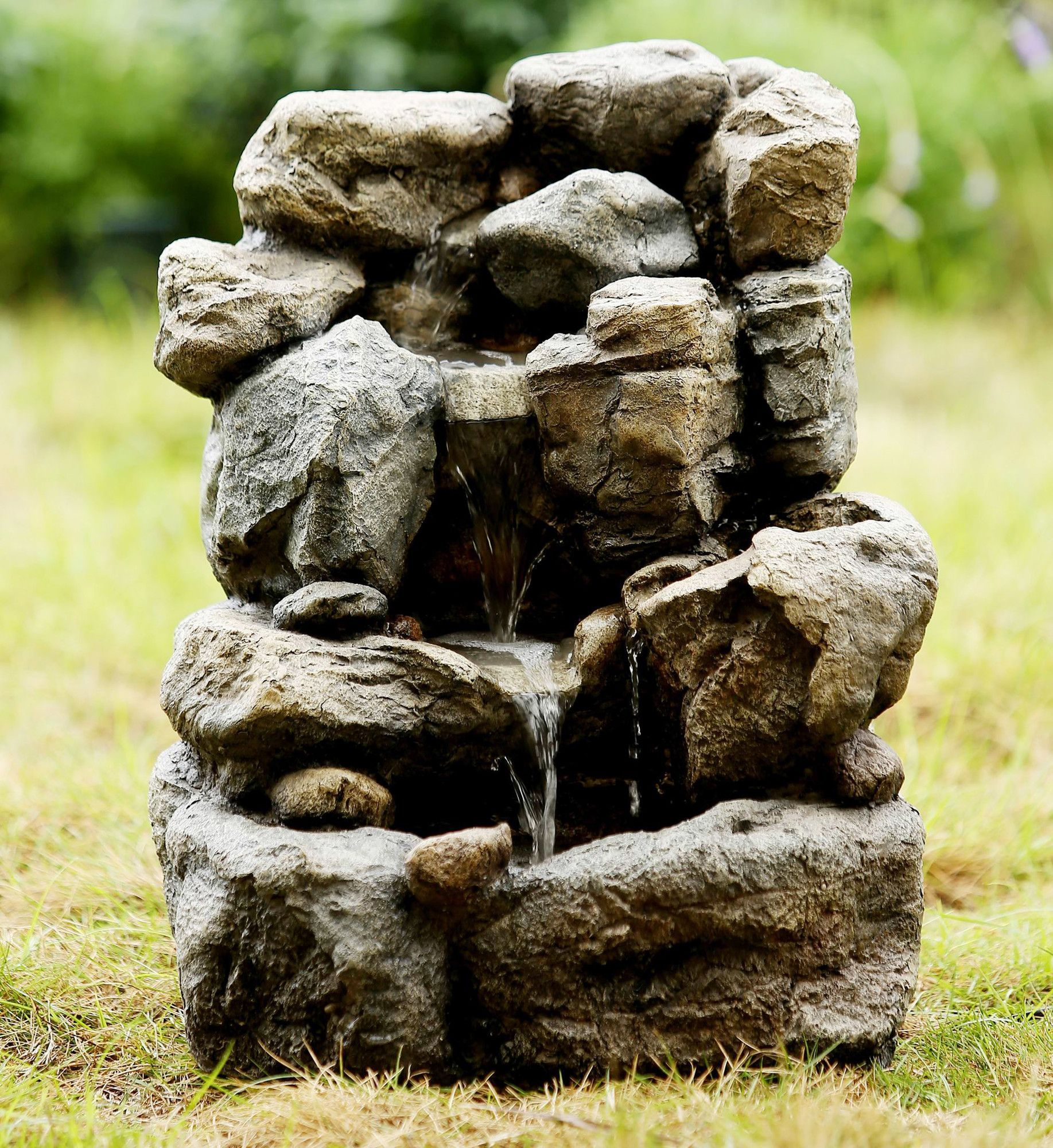 Features:  -Electric power.  -Output: 110V.  Material: -Fiberglass/Resin.  Style: -Traditional.  Fountain Design: -Rock.  Fountain Function: -Floor.  Fountain Location: -Outdoor/Garden.  Pump Included