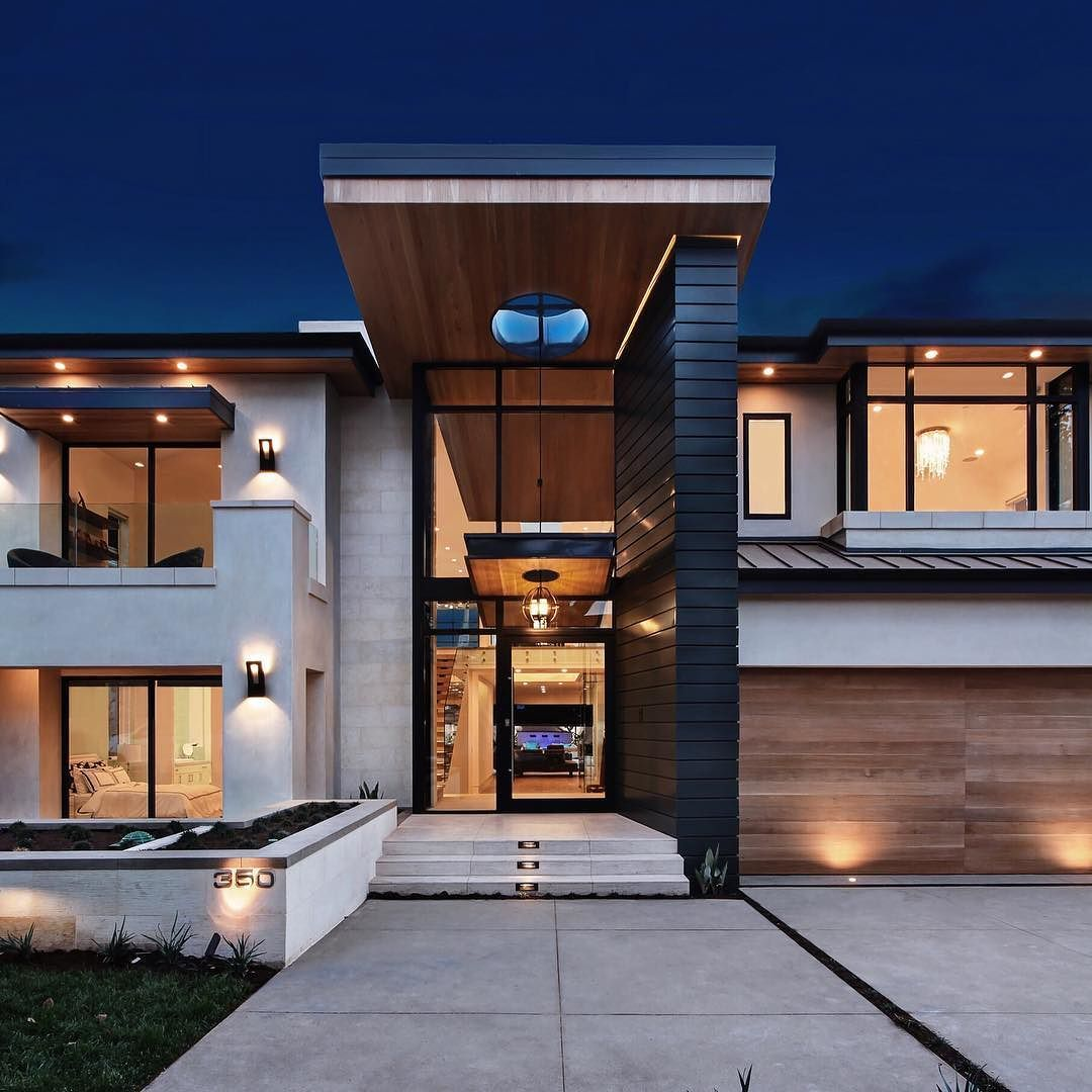 Zinc Shiplap Siding Gives This Modern Home The Perfect First Impression Ultra Modern Homes Modern House Design Modern House Plans