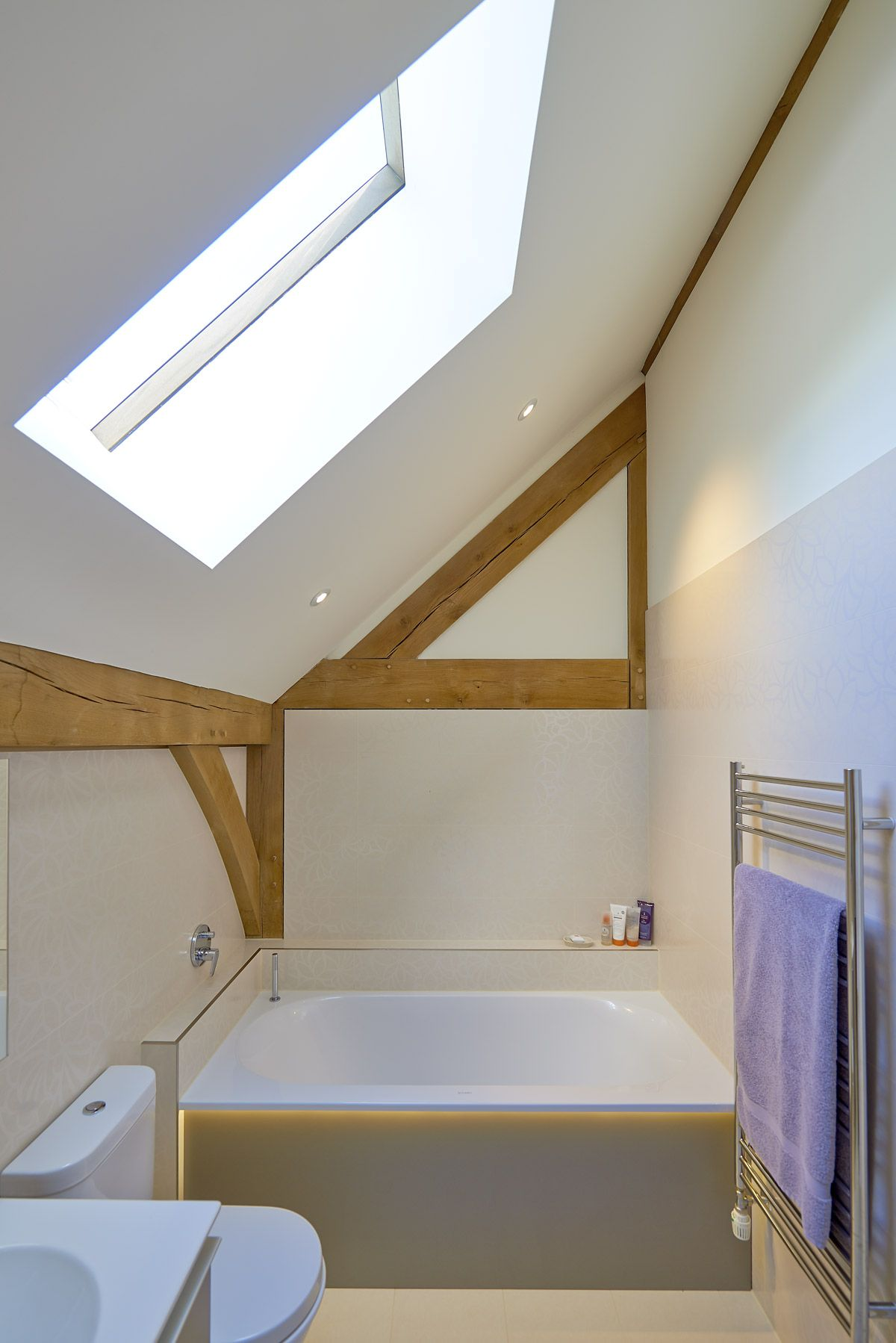 A large square bath tub was used to fill the space between both ...