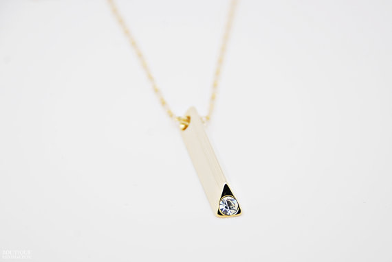 Vertical bar with rhinestone necklace