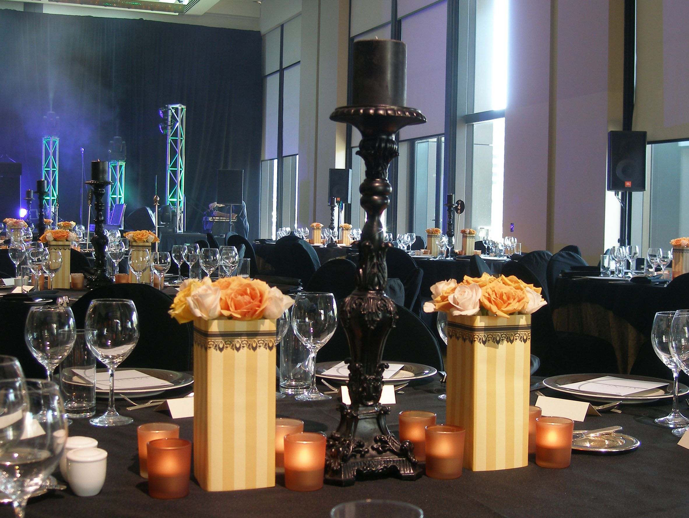 A Black And Gold Themed Corporate Event But With Blue And White