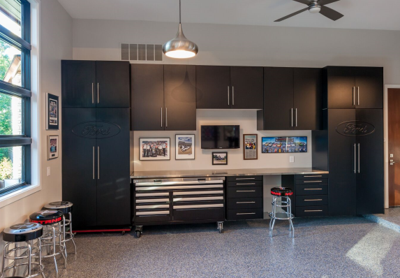 Fall in love with your garage! This project features custom cabinets, a work bench, and gridwall rack to store tools.